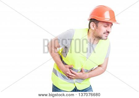 Sick Young Builder Suffering And Holding His Tummy