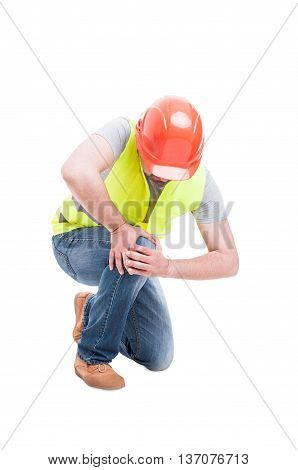 Male Constructor Kneeling And Suffering From Knee Pain