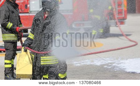 Firemen With The Fire Extinguisher During A Practice Session