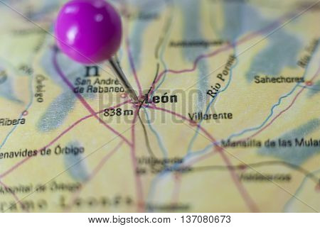 Pushpin marking on Leon Spain. Selective focus on city poster