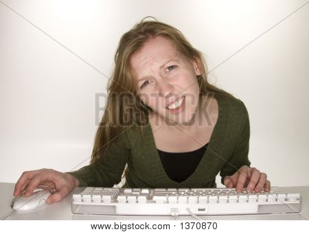 Confused Woman Viewing Computer Monitor