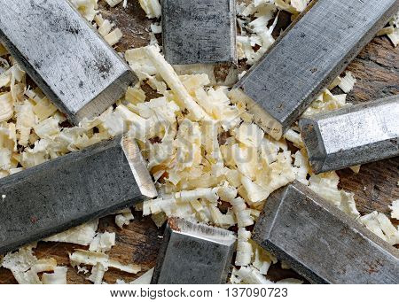 Series Of Many Sharp Steel Blades Many Chisels And Sawdust Chipp