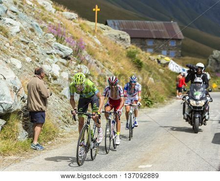 Col de la Croix de Fer France - 25 July 2015:Group of three cyclists Ryder Hesjedal of Team Cannondale-GarminJoaquim Rodriguez of Team Katusha and Thibaut Pinot of FDJ Team climbing to the Col de la Croix de Fer in Alps during the stage 20 of Le Tour de F