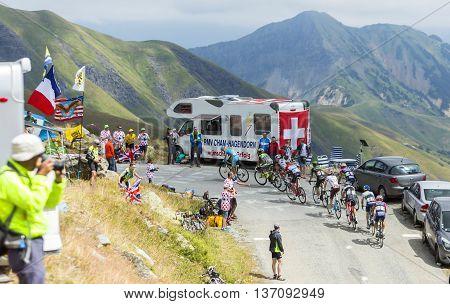 Col de la Croix de Fer France - 25 July 2015: The peloton including the cyclist Romain Bardet of AG2R La Mondiale Team in Polka Dot Jersey riding in a rocky natural environment at Col de la Croix de Fer in Alps during the stage 20 of Le Tour de France 201