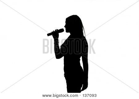 Silhouette Of Singing Girl