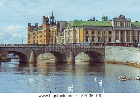 STOCKHOLM, SWEDEN - MARCH 30, 2016: View of the bay in the city center of Stockholm Sweden with the Arvfurstens Palats seat of the Ministry for Foreign Affairs