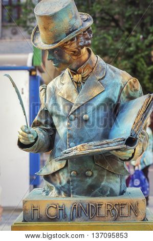 Bucharest,Romania - June 10,  2016: H. CH Andersen living statue at B-FIT in the Street. B-FIT is a cultural event that involves international artists and acrobats who act in theater plays on street.