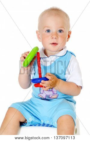 little funny baby boy holding toy on white background