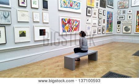 LONDON,UK - JUNE 26, 2016: A visitor views artwork during the