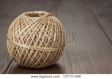 reel of durable thread on the wooden table