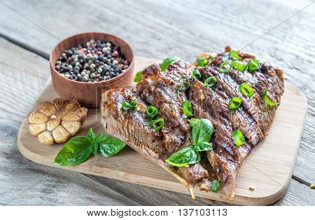 Grilled Turkey With Green Onion On The Wooden Board