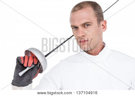 Portrait of swordsman holding fencing sword on white background