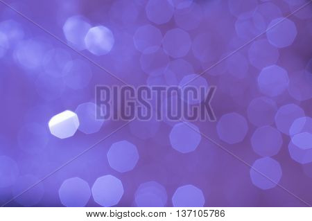 Abstract glittering purple violet bokeh background defocused