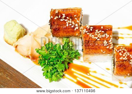 Unagi sushi, Roll of Cream Cheese and Avocado inside Topped with Smoked Eel