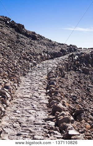 The mountain track made of stones at a volcano of Teide on the Canary Islands