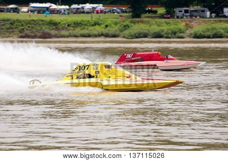 Madison Indiana - July 2 2016: Two hydorplanes racing in the National Modified Saturday qualification heat #3 at the Madison Regatta in Madison Indiana July 2 2016.