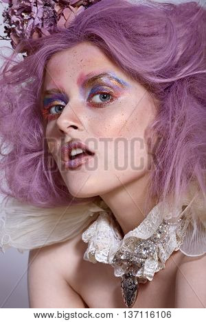 Girl with bright makeup and choker necklace. Purple hair