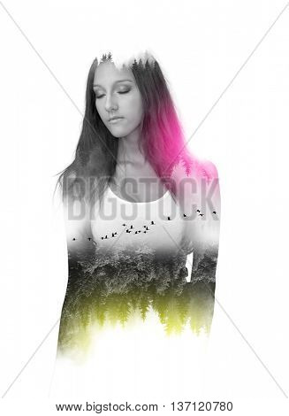 Upside down yellow trees and flock of flying birds in a double exposure portrait within shape of woman with eyes closed