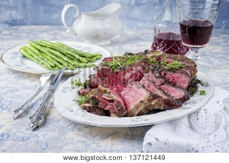 Sliced Porterhouse Steak with Green Asparagus on Plate
