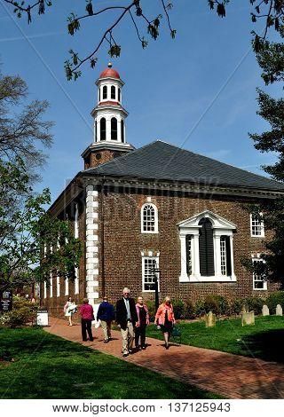 Alexandria Virginia - April 13 2014: Parishioners leaving Sunday services at the historic colonial-Georgian Christ Church built 1767-1773