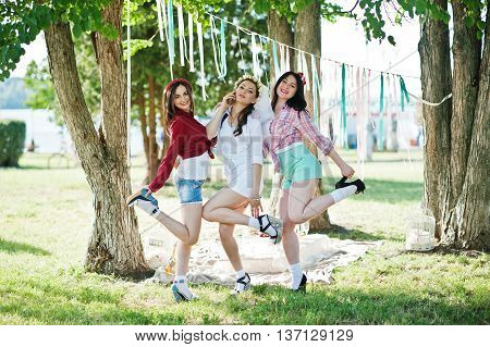 Three Cheerful Beautiful Girls In Short Shorts Posed Background Decoration At Bachelorette Party. Gi