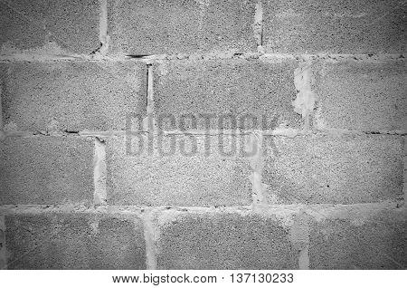 White grey grunge brick wall background .