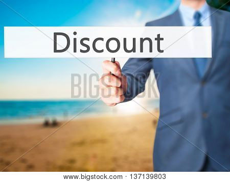 Discount - Businessman Hand Holding Sign