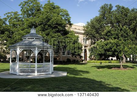 Texas county courthouse with gazebo in foreground.