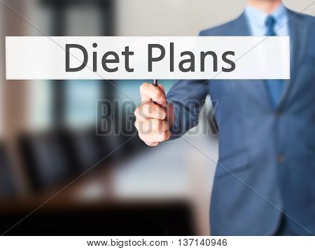 Diet Plans - Businessman Hand Holding Sign