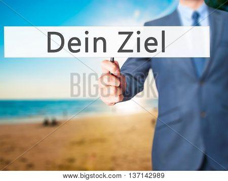Dein Ziel (your Goal In German) - Businessman Hand Holding Sign