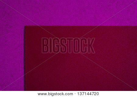 Eva foam ethylene vinyl acetate smooth red surface on pink sponge plush background