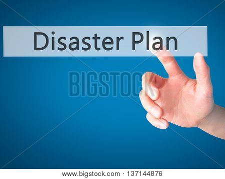 Disaster Plan - Hand Pressing A Button On Blurred Background Concept On Visual Screen.