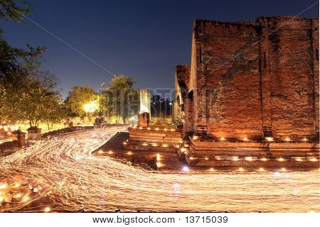Candle Light Trail Of Buddhism Ceremony At Temple Ruin On Asalha