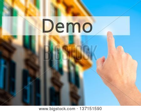 Demo - Hand Pressing A Button On Blurred Background Concept On Visual Screen.
