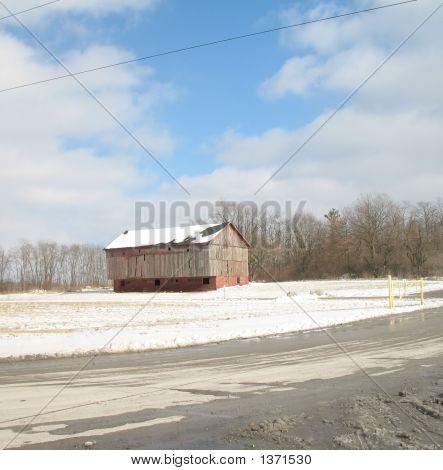 Barn In Snowy Field