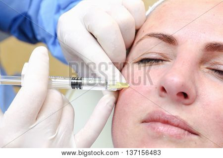 Anti-age injection therapy. Mimic wrinkles reduction in clinic