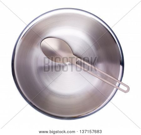 Tourist set: titan spoon and a steel bowl isolated on a white background