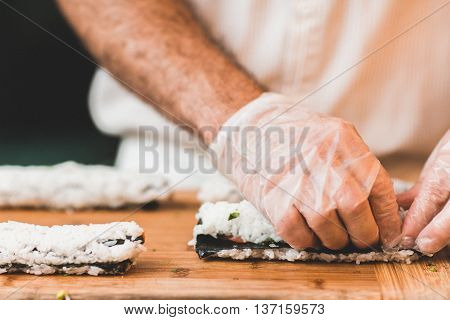 People making sushi in the cheff kitchen