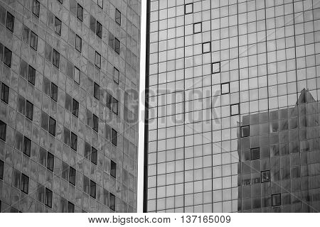 City architecture skycrapers with glass windows. Black and white photography.