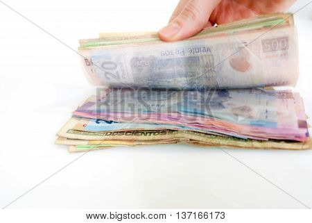 Hand counting money. Isolated on white background