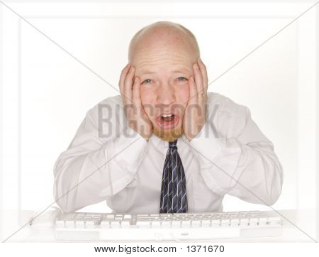 Upset Business Man Viewing Computer