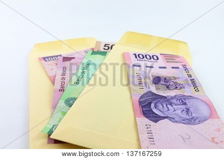 An envelope showing bills of various denominations