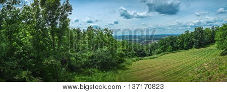Summer mountain tops with blue sky cloudscape