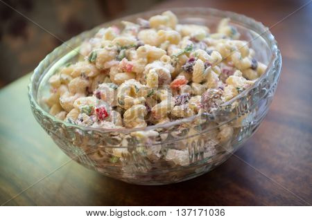 Chicken and macaroni salad in large glass serving bowl