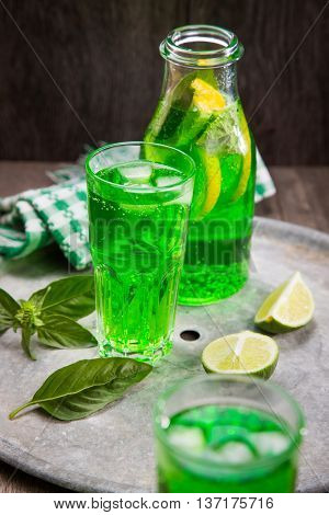 drink from estragon with citrus and basil in studio poster