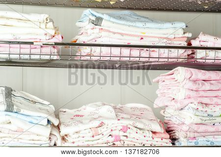 Children's Clothing For Newborns At Shelf In Shop