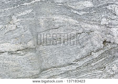 Textured background of a granite rock polished be glaciers during the ice age.