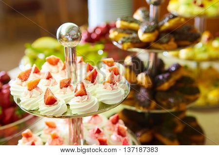 Dessert table for a party. akes and sweetness. Shallow dof