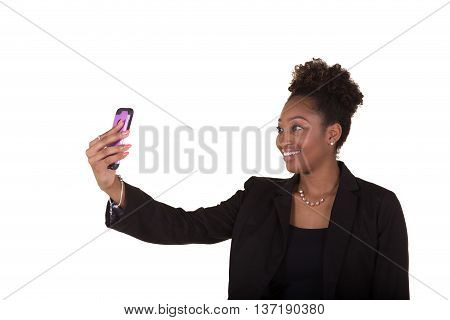 A young woman using her cell phone isolated on white
