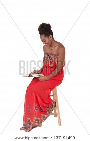 A young woman with a book isolated on white
